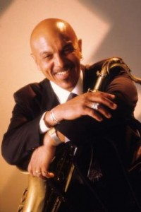 Kenny Blake poses with Saxophone for wedding and company party entertainment