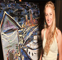 Girl in front of a painting at an entertainment unlimited event in pittsburgh