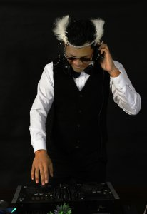 Entertainment unlimited wedding dj at his turntables