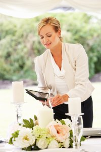wedding planner making sure all the wedding details are correct.